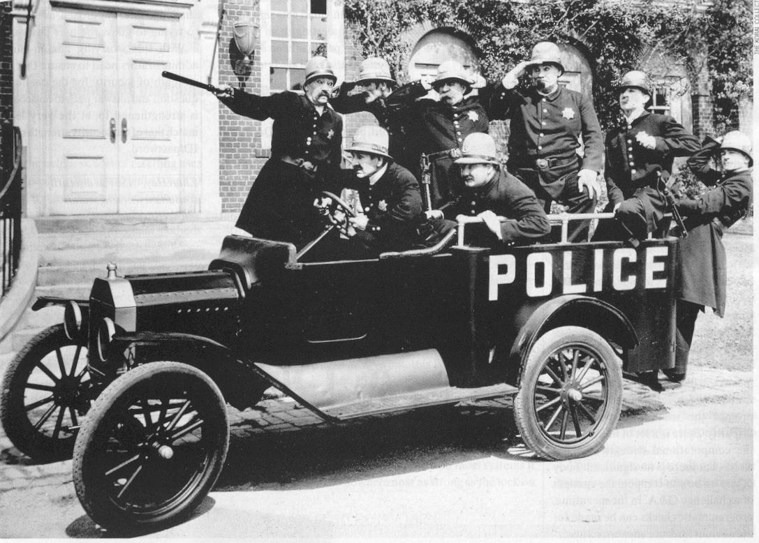 Black and white of early nineteen hundreds police vehicle